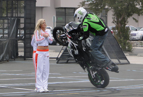 Stunt rider circles Hooters girls