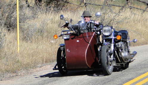 Glyn McDowell driving his rig from the sidecar